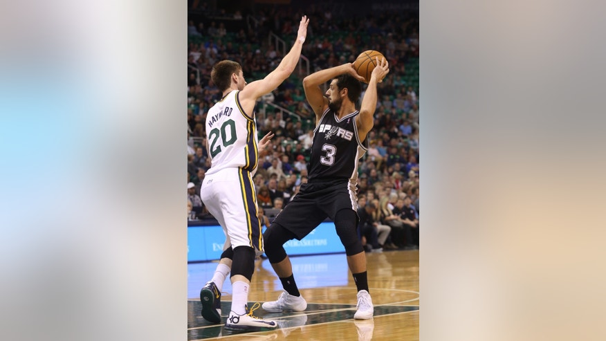 San Antonio Spurs' Marco Belinelli (3) looks to pass the ball as Utah Jazz's Gordon Hayward (20) defends in the first half of an NBA basketball game on Saturday, Dec. 14, 2013, in Salt Lake City. (AP Photo/Kim Raff)