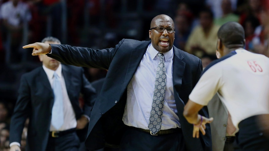Cleveland Cavaliers coach Mike Brown protest a foul call against his team to game official Sean Wright (65) during the first half of a NBA basketball game against the Miami Heat in Miami, Saturday, Dec. 14, 2013. (AP Photo/J Pat Carter)