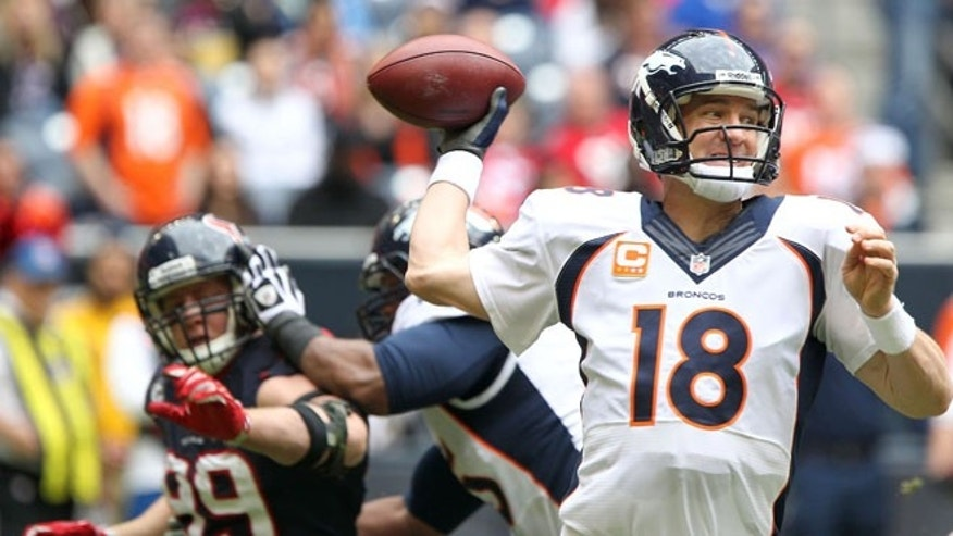 Dec. 22, 2013: Denver Broncos quarterback Peyton Manning (18) drops back to pass during the first half of an NFL football game against the Houston Texans in Houston.