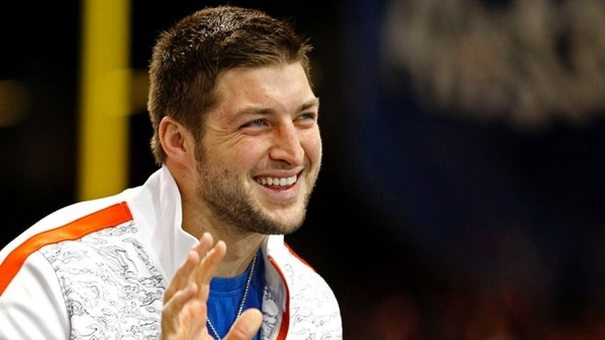 Jan. 2, 2013: Former Florida Gators quarterback Tim Tebow waves as he stands on the sidelines before the Gators play against the Louisville Cardinals in the 2013 Allstate Sugar Bowl NCAA football game in New Orleans, Louisiana.