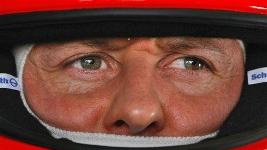 Schumacher pictured in the pits at the Formula One Bahrain International Circuit in Sakhir, Bahrain, on March 12, 2010.