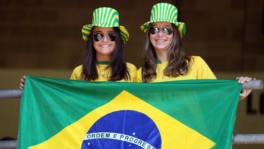 CARDIFF, WALES - JULY 28:  Brazil fans show their support during the Women's Football first round Group E match between New Zealand and Brazil on Day 1 of the London 2012 Olympic Games at Millennium Stadium on July 28, 2012 in Cardiff, Wales.  (Photo by Julian Finney/Getty Images)
