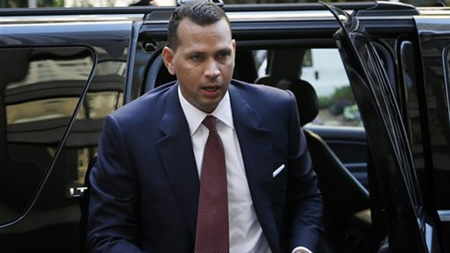 Alex Rodriguez arrives at MLB headquarters in New York, Tuesday, Nov. 19, 2013.