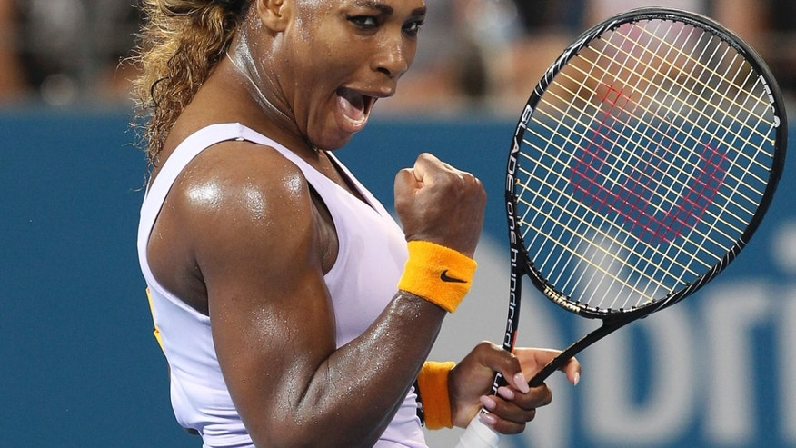 Serena Williams of the U.S. celebrates upon beating Maria Sharapova of Russia 6-2, 7-6 in their semifinal match during the Brisbane International tennis tournament in Brisbane, Australia, Friday, Jan. 3, 2014. (AP Photo/Tertius Pickard)