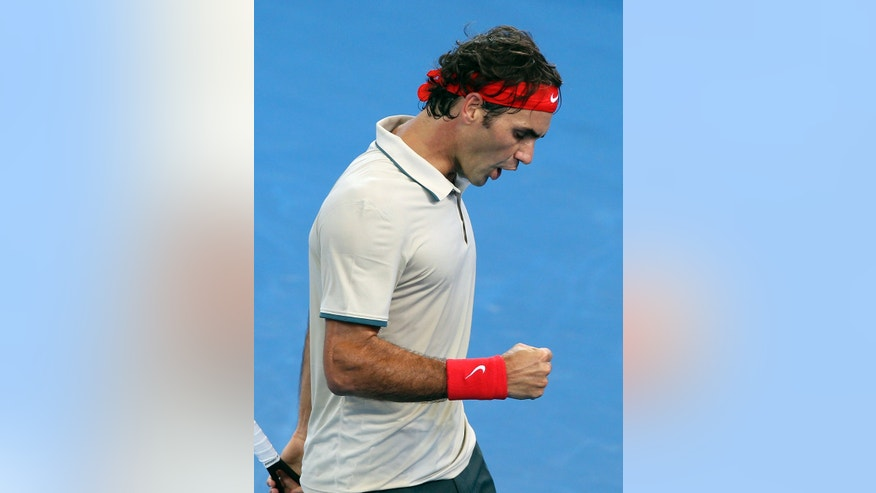 Roger Federer of Switzerland reacts after winning a point in men's final match against Lleyton Hewitt of Australia during the Brisbane International tennis tournament in Brisbane, Australia, Sunday, Jan. 5, 2014. (AP Photo/Tertius Pickard)