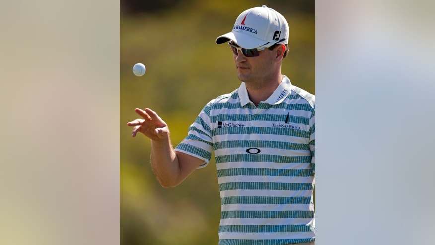 Zach Johnson juggles a golf ball as he walks off the 17th green during the second round of the Tournament of Champions golf tournament, Saturday, Jan. 4, 2014, in Kapalua, Hawaii. (AP Photo/Marco Garcia)
