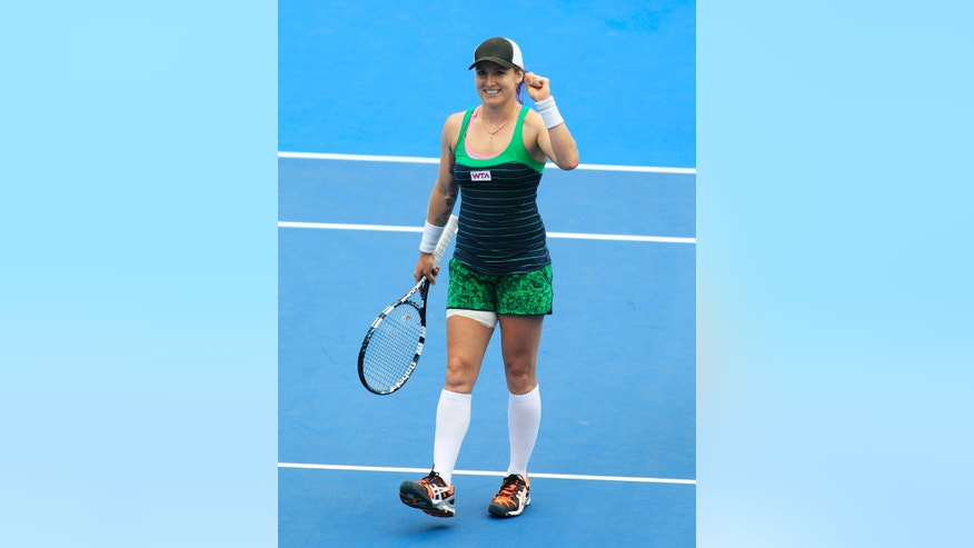 Bethanie Mattek-Sands of the U.S. reacts after defeating Agnieszka Radwanska of Poland during their women's singles match at the Sydney International tennis tournament in Sydney, Australia, Tuesday, Jan. 7, 2014.  (AP Photo/Daniel Munoz)