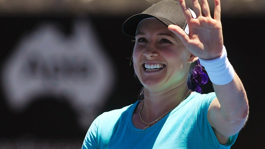 Bethanie Mattek-Sands of the U.S. acknowledges the crowd after defeating Eugenie Bouchard of Canada during their women's singles match at the Sydney International tennis tournament in Sydney, Australia, Monday, Jan. 6, 2014.  (AP Photo/Daniel Munoz)