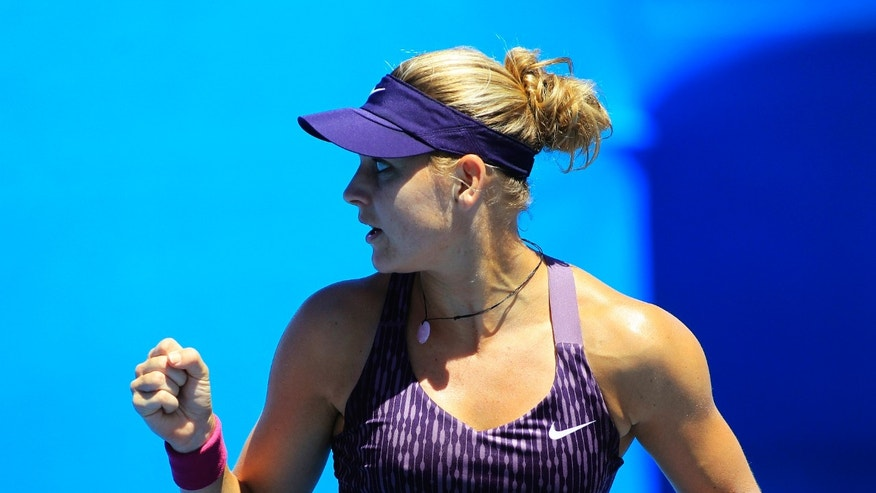 Lucie Safarova of the Czech Republic reacts after winning a point against Francesca Schiavone of Italy during their women's singles match at the Sydney International tennis tournament in Sydney, Australia, Monday, Jan. 6, 2014.  (AP Photo/Daniel Munoz)