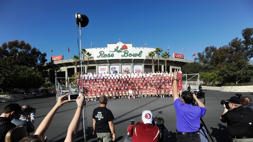 Florida State head coach Jimbo Fisher and the Seminole football team and staff pose for the official group photo outside the Rose Bowl in Pasadena, Calif., Sunday, Jan. 5, 2014. FSU will play Auburn in the BCS Championship NCAA college football game Jan. 6. (AP Photo/The Florida Times-Union, Bob Self)