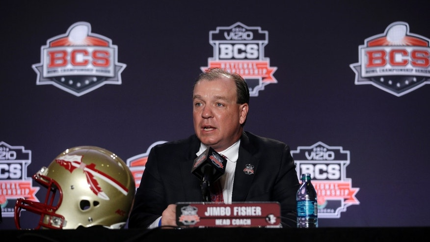 Florida State head coach Jimbo Fisher answers a question during a news conference for the NCAA BCS National Championship college football game Sunday, Jan. 5, 2014, in Newport Beach, Calif. Florida State plays Auburn on Monday, Jan. 6, 2014. (AP Photo/Morry Gash)