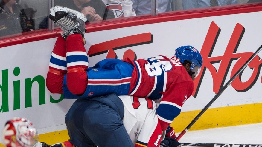 Montreal Canadiens' P.K. Subban falls over Florida Panthers' Drew Shore during second period of an NHL hockey game, Monday, Jan. 6, 2014 in Montreal. (AP Photo/The Canadian Press, Paul Chiasson)