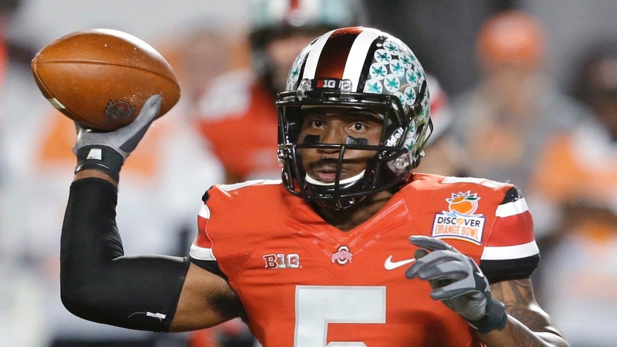 FILE -  In this Jan. 3, 2014 file photo, Ohio State quarterback Braxton Miller passes the football during the first half of the Orange Bowl NCAA college football game against Clemson, Friday, Jan. 3, 2014, in Miami Gardens, Fla. Ohio State ended the season with a two game losing streak. (AP Photo/Wilfredo Lee, File)