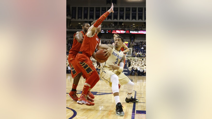 Pittsburgh's Cameron Wright (3) passes around Maryland's Evan Smotrycz (1) in the first half of an NCAA college basketball game on Monday, Jan. 6, 2014, in Pittsburgh. (AP Photo/Keith Srakocic)