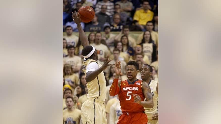 Pittsburgh's Durand Johnson, left, blocks a pass by Maryland's Nick Faust (5) in the first half of an NCAA college basketball game on Monday, Jan. 6, 2014, in Pittsburgh. (AP Photo/Keith Srakocic)