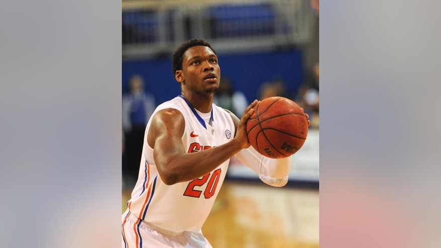 Florida guard Michael Frazier II (20) sets up to make one of his game-total 18 points during the second half of an NCAA college basketball game against Richmond in Gainesville, Fla., Saturday, Jan. 4, 2014. Florida defeated Richmond 67-58. (AP Photo/Phil Sandlin)