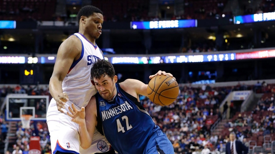 Minnesota Timberwolves' Kevin Love (42) tries to get past Philadelphia 76ers' Daniel Orton during the first half of an NBA basketball game, Monday, Jan. 6, 2014, in Philadelphia. (AP Photo/Matt Slocum)