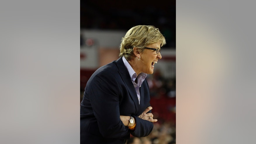 Tennessee  head coach Holly Warlick directs her team from the bench in the second half of an NCAA college basketball game against Georgia, Sunday, Jan. 5, 2014, in Athens, Ga. Tennessee won 85-70. (AP Photo/John Bazemore)