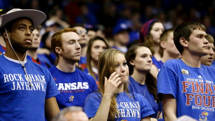 Kansas fans watch the final moments of an NCAA college basketball game against San Diego State, Sunday, Jan. 5, 2014, in Lawrence, Kan. San Diego State won 61-57. (AP Photo/Charlie Riedel)