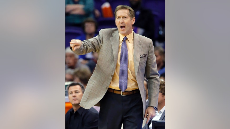 Phoenix Suns head coach Jeff Hornacek yells to his team during the first half of an NBA basketball game against the Milwaukee Bucks, Saturday, Jan. 4, 2014, in Phoenix. (AP Photo/Matt York)