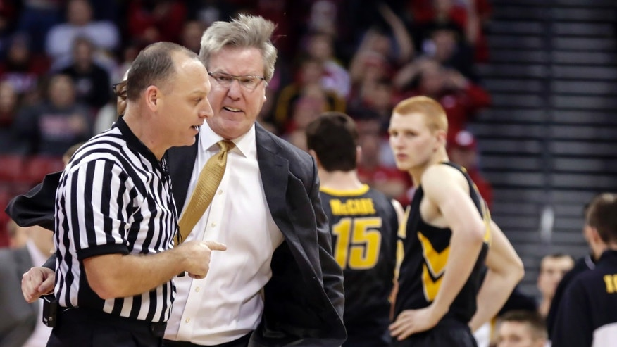 Iowa coach Fran McCaffery, second from left, argues a call during the second half of an NCAA college basketball game against Wisconsin, Sunday, Jan. 5, 2014, in Madison, Wis. McCaffery was ejected from the game and Iowa was charged with two technical fouls. Wisconsin won 75-71. (AP Photo/Andy Manis)
