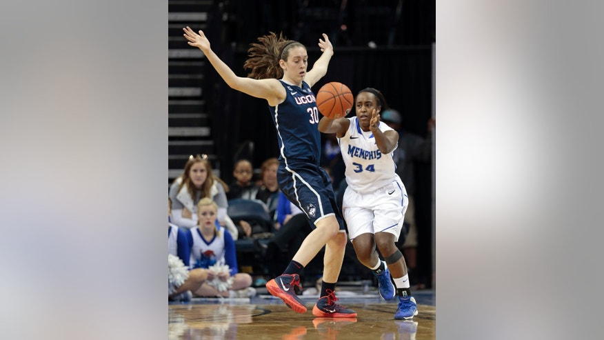 Memphis guard Devin Mack (34) passes around Connecticut forward Breanna Stewart (30) in the second half of an NCAA college basketball game Saturday, Jan. 4, 2014, in Memphis, Tenn. (AP Photo/Mark Humphrey)