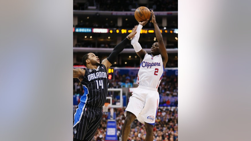 Los Angeles Clippers' Darren Collison, right, shoots over Orlando Magic's Jameer Nelson, left, during the first half of an NBA basketball game in Los Angeles, Monday, Jan. 6, 2014. (AP Photo/Danny Moloshok)