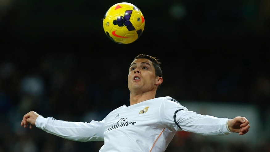 Ronaldo controls the ball during a soccer match between Real Madrid and Celta Vigo in Madrid, Spain, Jan. 6, 2014.