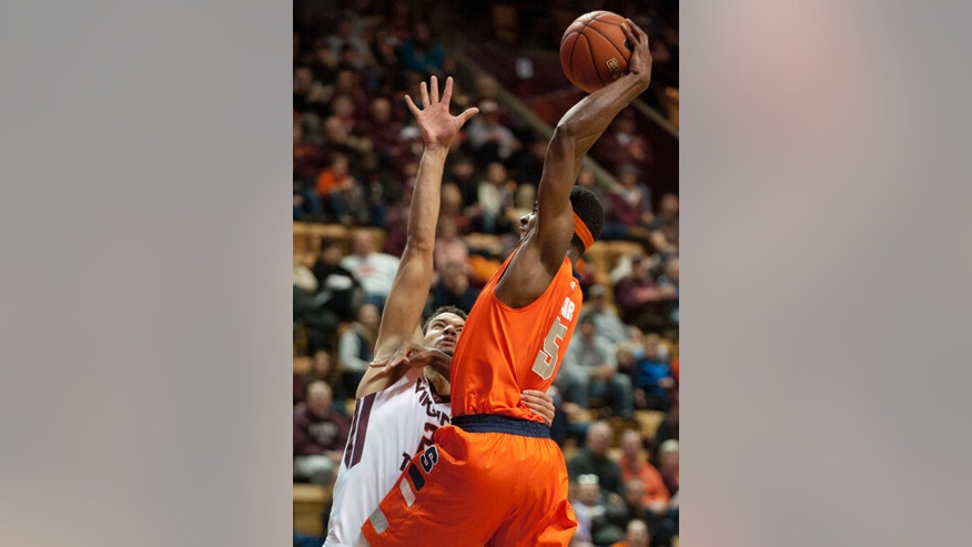 Syracuse's C.J. Fair (5) goes up for a dunk against Virginia Tech's Joey van Zegeren (2) during the first half of an NCAA college basketball game Tuesday, Jan. 7, 2014, in Blacksburg, Va. (AP Photo/Don Petersen)