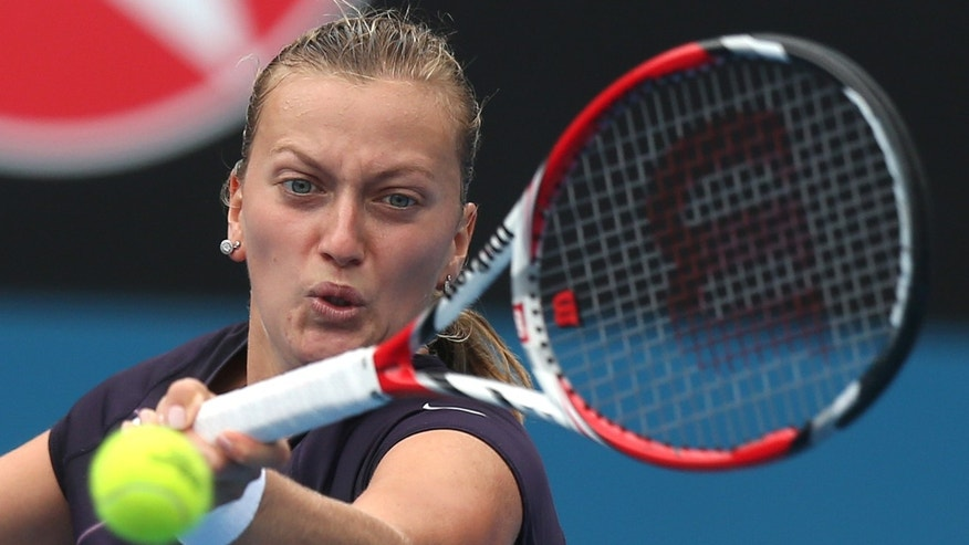 Petra Kvitova of the Czech Republic plays a shot to fellow countrywoman Lucie Safarova during their women's singles match at the Sydney International tennis tournament in Sydney, Wednesday, Jan. 8, 2014. (AP Photo/Rick Rycroft)