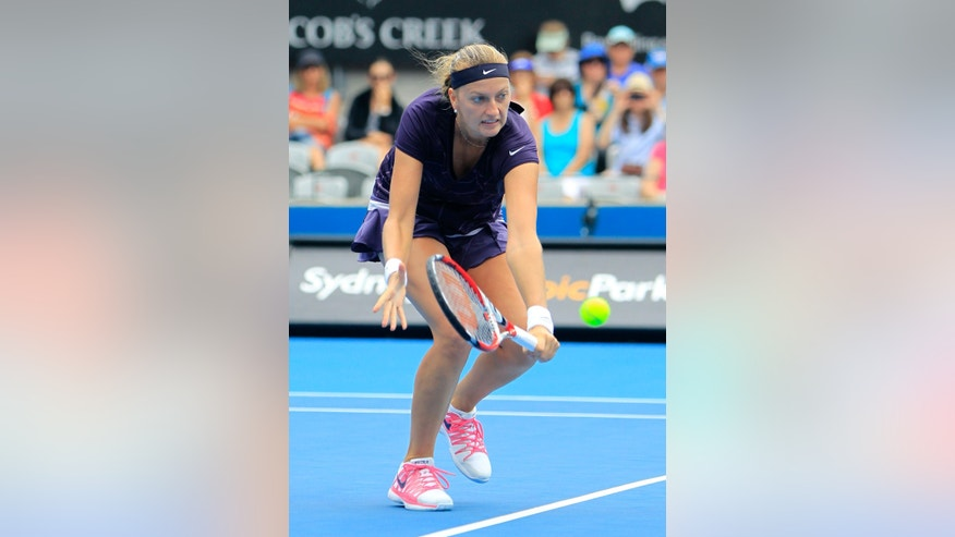 Petra Kvitova of the Czech Republic hits a backhand to Christina McHale of the U.S. during their women's singles match at the Sydney International tennis tournament in Sydney, Australia, Tuesday, Jan. 7, 2014.  (AP Photo/Daniel Munoz)