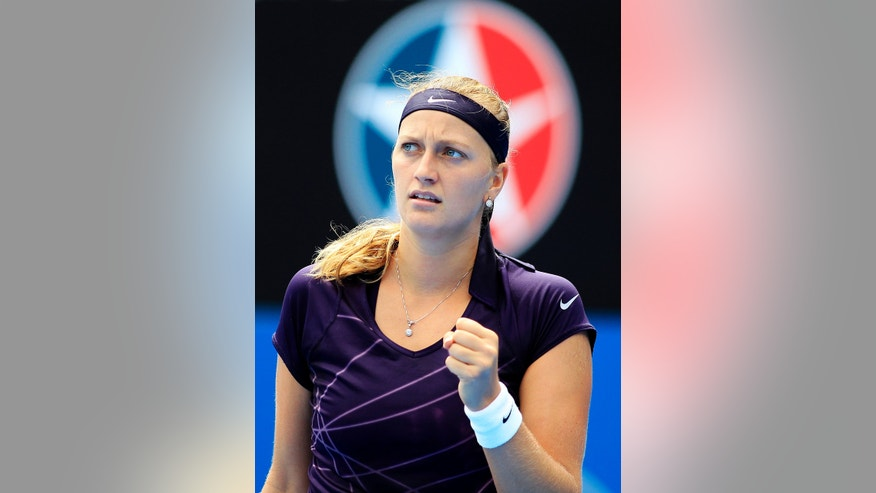 Petra Kvitova of the Czech Republic reacts after winning a point against Christina McHale of the U.S. during their women's singles match at the Sydney International tennis tournament in Sydney, Australia, Tuesday, Jan. 7, 2014.  (AP Photo/Daniel Munoz)
