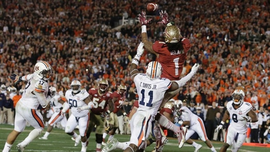 Florida State's Kelvin Benjamin catches the game-winning touchdown pass during the second half of the NCAA BCS National Championship college football game against Auburn Monday, Jan. 6, 2014, in Pasadena, Calif. (AP Photo/Chris Carlson)