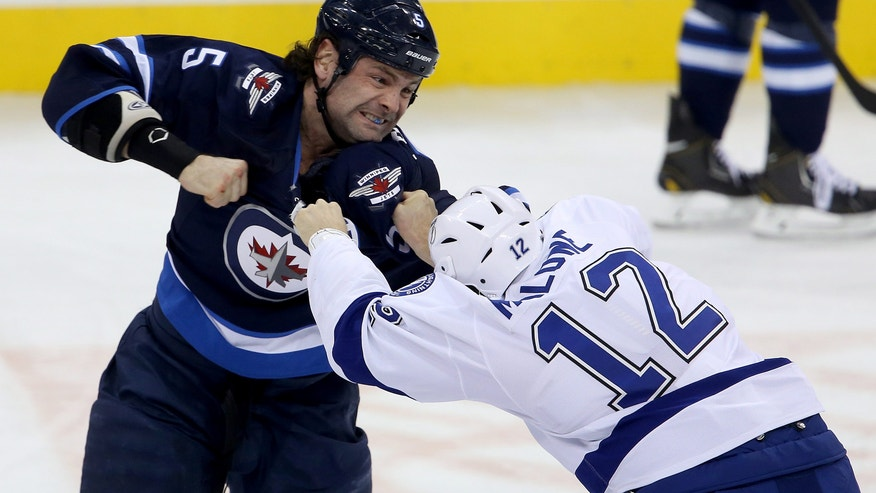 Winnipeg Jets' Mark Stuart (5) fights Tampa Bay Lightning's Ryan Malone (12) during the first period of an NHL hockey game Tuesday, Jan. 7, 2014, in Winnipeg, Manitoba. (AP Photo/The Canadian Press, Trevor Hagan)