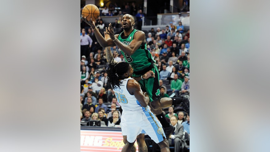 Boston Celtics forward Jeff Green is called for an offensive foul as he runs into Denver Nuggets forward Kenneth Faried on a shot attempt in the first half of an NBA basketball game on Tuesday, Jan. 7, 2014, in Denver.  (AP Photo/Chris Schneider)