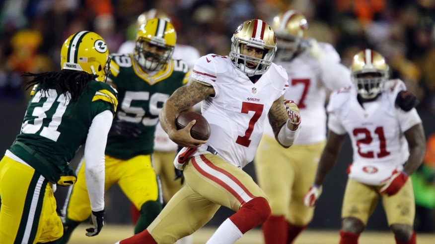 San Francisco 49ers quarterback Colin Kaepernick (7) runs against Green Bay Packers defense during the first half of an NFL wild-card playoff football game, Sunday, Jan. 5, 2014, in Green Bay, Wis. (AP Photo/Jeffrey Phelps)