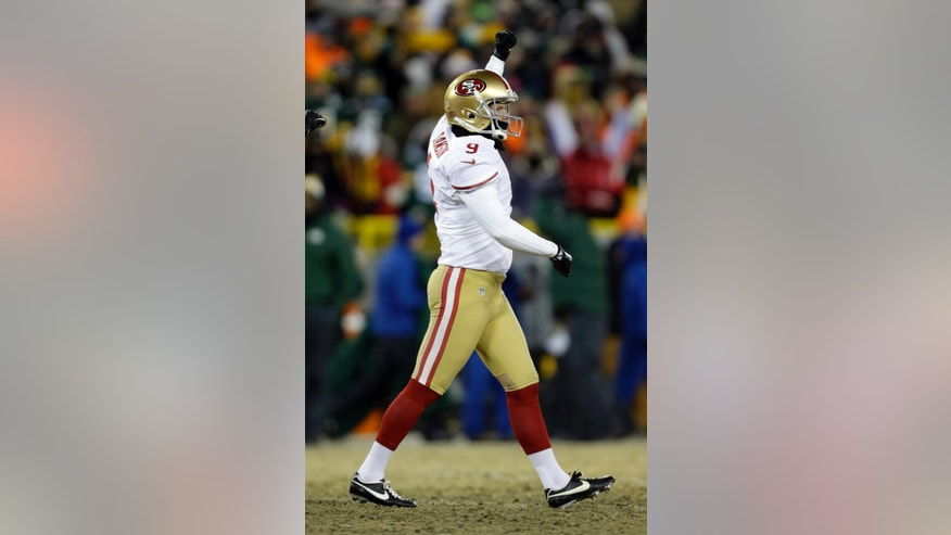 San Francisco 49ers kicker Phil Dawson (9) celebrates after kicking the game-winning field goal during the second half of an NFL wild-card playoff football game, Sunday, Jan. 5, 2014, in Green Bay, Wis. The 49ers won 23-20. (AP Photo/Jeffrey Phelps)