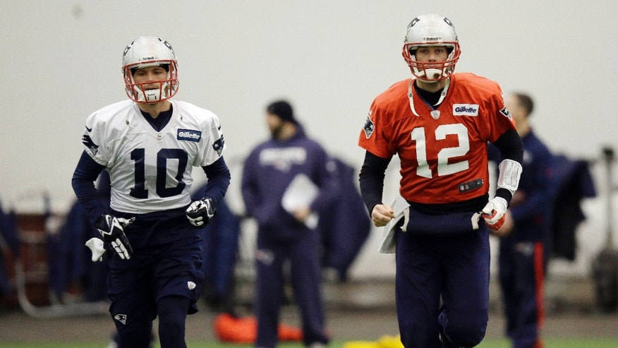 New England Patriots quarterback Tom Brady (12) and wide receiver Austin Collie (10) run during a stretching session before NFL football practice at the team's facility in Foxborough, Mass., Tuesday, Jan. 7, 2014. The Patriots are scheduled to host the Indianapolis Colts in an NFL football divisional playoff game on Saturday, Jan. 11. (AP Photo/Stephan Savoia)