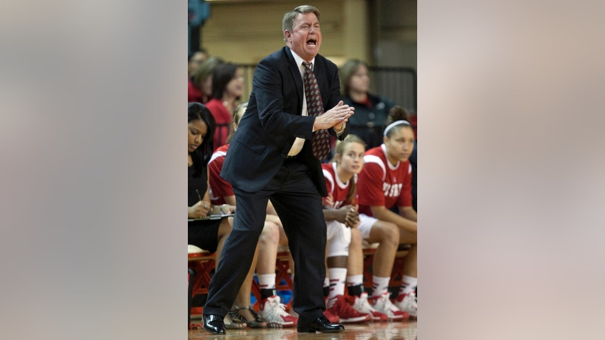 In this Dec. 8, 2013 photo, North Carolina State women's NCAA college basketball head coach Wes Moore directs his team against Elon, at Reynolds Coliseum in Raleigh, N.C. First-year coach Moore has the North Carolina State women's program ranked again for the first time since the end of the 2006-07 season. (AP Photo/The News & Observer, Corey Lowenstein) MANDATORY CREDIT