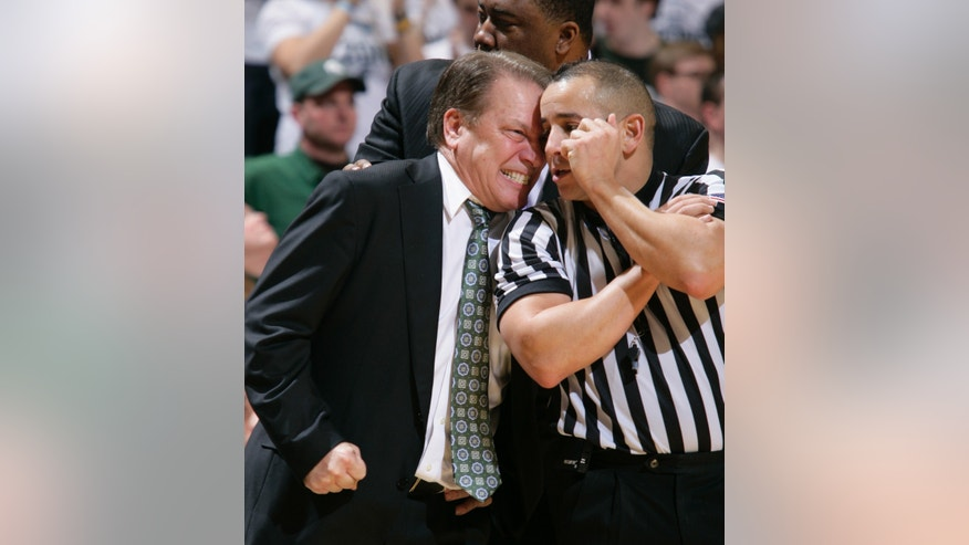 Michigan State coach Tom Izzo, left, has words for official Larry Scirotto during the second half of an NCAA college basketball game against Ohio State, Tuesday, Jan. 7, 2014, in East Lansing, Mich. Michigan State won 72-68 in overtime. (AP Photo/Al Goldis)