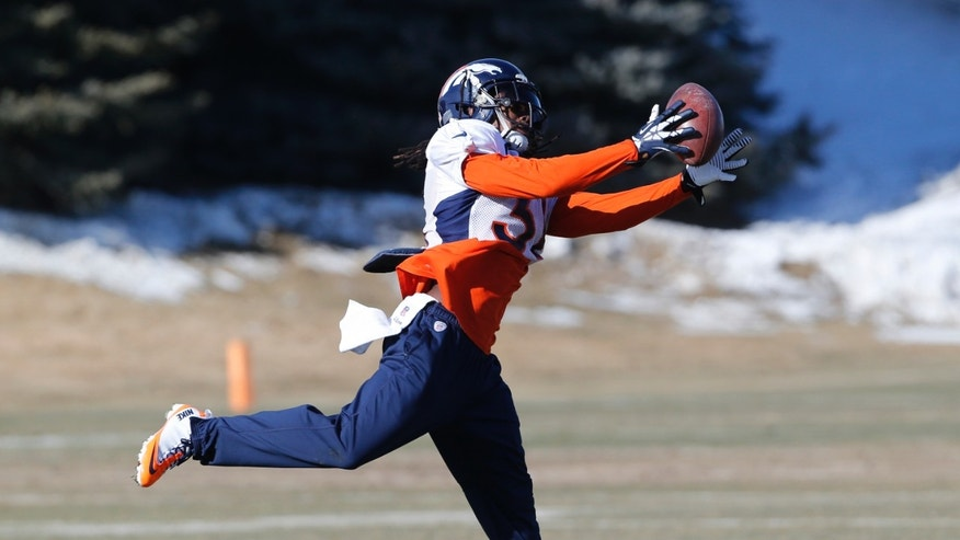 Denver Broncos strong safety Omar Bolden (31) catches a football at practice for the football team's NFL playoff game against the San Diego Chargers at the Broncos training facility in Englewood, Colo., on Wednesday, Jan. 8, 2014. AP Photo/Ed Andrieski)