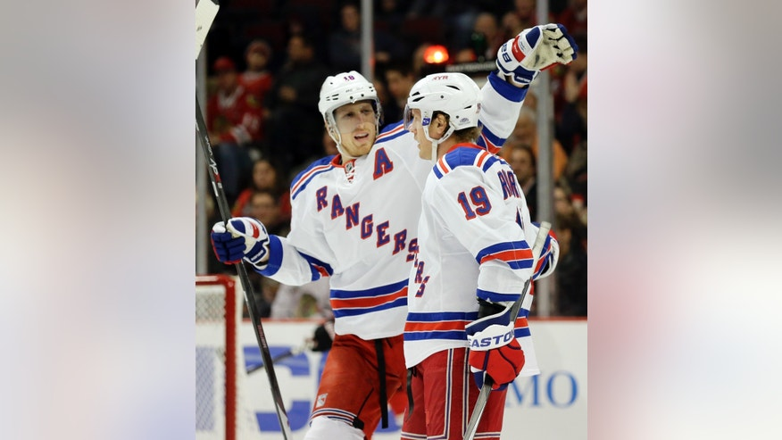 New York Rangers' Brad Richards (19) celebrates with teammate Marc Staal (18) after scoring a goal against the Chicago Blackhawks during the first period of an NHL hockey game in Chicago, Wednesday, Jan. 8, 2014. (AP Photo/Nam Y. Huh)