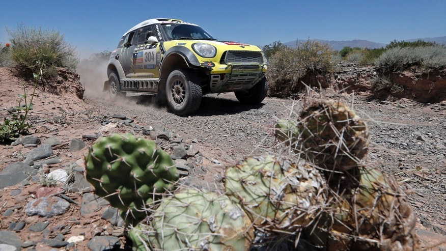 "Mini driver Joan ""Nani"" Roma of Spain and co-pilot Michel Perin of France races during the third stage of the Dakar Rally between the cities of San Rafael and San Juan in San Juan, Argentina, Tuesday, Jan. 7, 2014. (AP Photo/Jean-Paul Pleissier, Pool)"