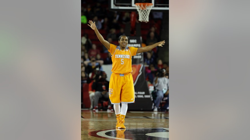 Tennessee guard Ariel Massengale (5) reacts in the closing moments of the second half of an NCAA college basketball game against Georgia, Sunday, Jan. 5, 2014, in Athens, Ga. Tennessee won 85-70. (AP Photo/John Bazemore)