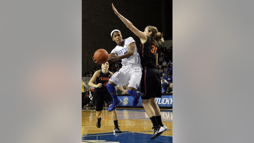 Kentucky's Janee Thompson, left, passes around Florida's Lily Svete during the second half of an NCAA college basketball game on Sunday, Jan. 5, 2014, in Lexington, Ky. Florida won 83-73. (AP Photo/James Crisp)