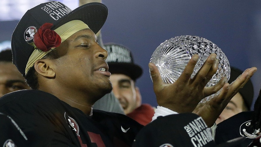 Florida State's Jameis Winston with The Coaches' Trophy after the NCAA BCS National Championship college football game against Auburn Monday, Jan. 6, 2014, in Pasadena, Calif. Florida State won 34-31. (AP Photo/David J. Phillip)