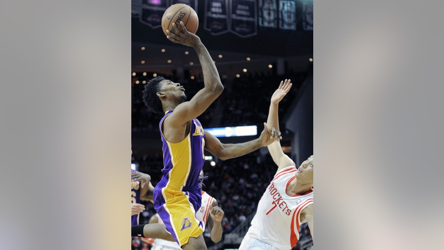 Los Angeles Lakers' Nick Young, left, shoots over Houston Rockets' Jeremy Lin (7) in the first half of an NBA basketball game on Wednesday, Jan. 8, 2014, in Houston. (AP Photo/Pat Sullivan)
