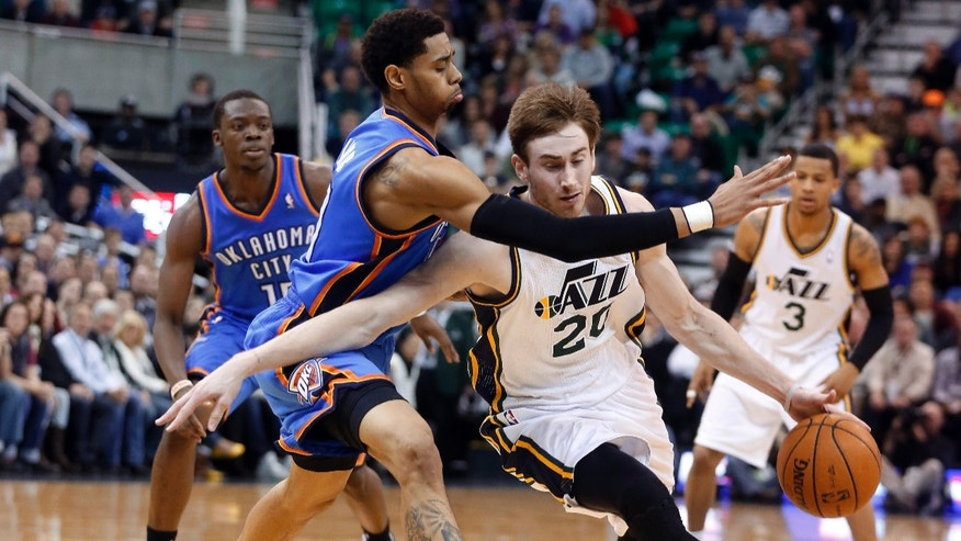 Utah Jazz guard Gordon Hayward (20) is defended by Oklahoma City Thunder guard Jeremy Lamb (11) during the second half of their NBA basketball game in Salt Lake City, Tuesday, Jan. 7, 2014. The Jazz won 112-101. (AP Photo/Jim Urquhart)