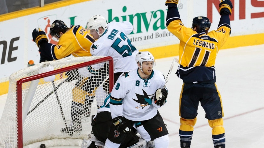 Nashville Predators forward David Legwand (11) celebrates a goal by teammate Mattias Ekholm, not shown, against the San Jose Sharks in the second period of an NHL hockey game Tuesday, Jan. 7, 2014, in Nashville, Tenn. Defending for the Sharks are Joe Pavelski (8) and Matt Irwin (52). (AP Photo/Mark Humphrey)
