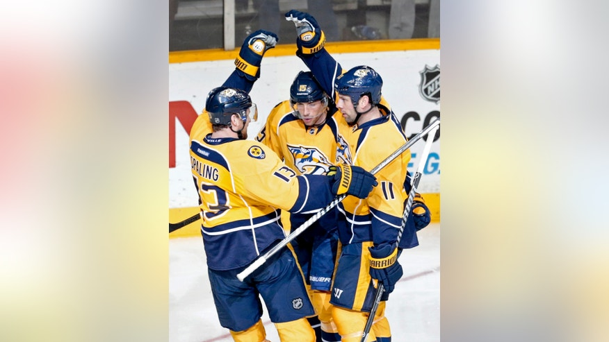 Nashville Predators forward David Legwand (11) celebrates with Nick Spaling (13) and Craig Smith (15) after Legwand scored against the San Jose Sharks in the second period of an NHL hockey game Tuesday, Jan. 7, 2014, in Nashville, Tenn. (AP Photo/Mark Humphrey)